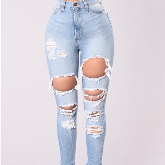 sold worldwide diverse styles in stock Light Blue Distressed Jeans from Fashion Nova